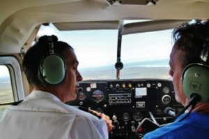 Evan Austin and Paco Nadal in the plane flying over Walker Bay