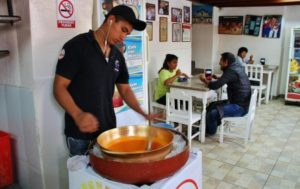 Handcrafted elaboration of typical paila ice cream in Ibarra near Quito