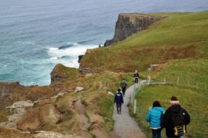 Hiking on Cliffs of Moher in Ireland