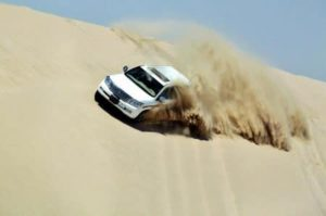 Surfing through the dunes in 4 × 4 in the Qatar desert near Doha