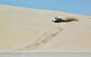 Surfing through the dunes in 4 × 4 in the Qatar desert near Doha