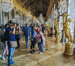 Tourists at the Palace of Versailles near Paris